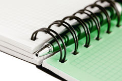 Open notebook with green pen Stock Photos