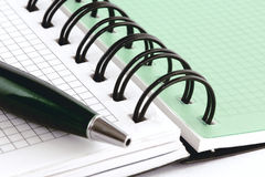 Open notebook with green pen Royalty Free Stock Photography