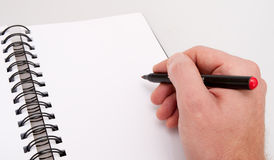 Open Notebook and Hand With Marker Stock Photo