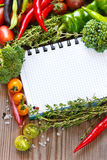 Open notebook and harvest. Royalty Free Stock Photography