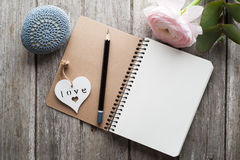 Open notebook, heart, paperweight. And flower on shabby wooden table. Concept for journaling, dairy Royalty Free Stock Images