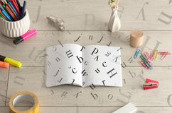 Open notebook with letters on it Royalty Free Stock Image