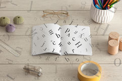 Open notebook with letters on it Royalty Free Stock Photography
