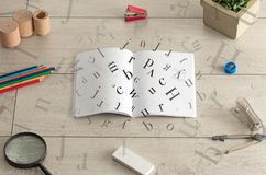 Open notebook with letters on it Royalty Free Stock Photos
