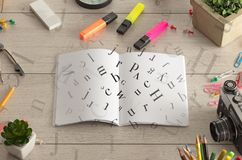 Open notebook with letters on it Royalty Free Stock Photo