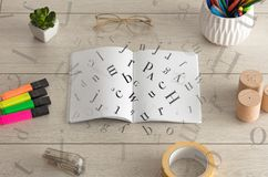 Open notebook with letters on it Stock Photo