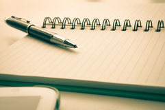 Open notebook with metallic ball pen and tablet Royalty Free Stock Photos