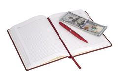 Open notebook and money. On a white background stock photography