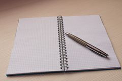 Open notebook with multi-colored markers . On light background.  Stock Image