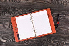 Open notebook on old boards. Handle. Top view Stock Photography