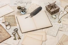 Open notebook, old letters and accessories Stock Photos