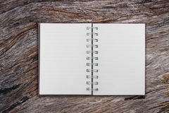 Open notebook on  old teak wood Royalty Free Stock Images