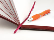 Open notebook and pen Royalty Free Stock Photos