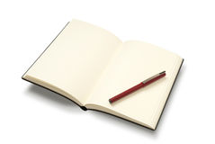 Open notebook with pen. Plain open notebook and pen. Isolated on white with path Stock Photography