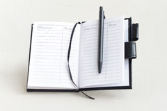 Open notebook and pen Stock Photography