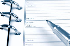 Open notebook and pen Stock Photo