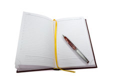 Open notebook and a pen Royalty Free Stock Photography