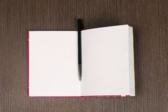 Open notebook pen Stock Images