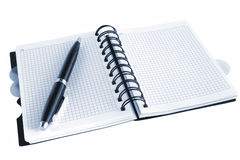 Open notebook and pen, with blue tint Stock Photography
