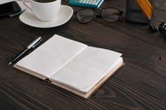 Open notebook with pen closeup Stock Photo