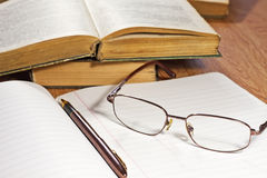 Open notebook with pen and glasses Stock Images