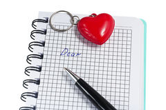 Open notebook with pen and heart Royalty Free Stock Images