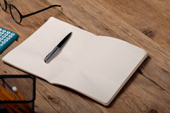 Open notebook with pen on the office table Stock Image