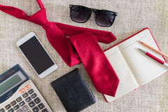 Open notebook, pen, pencil, smartphone, wallet, sunglasses on cl Royalty Free Stock Photo