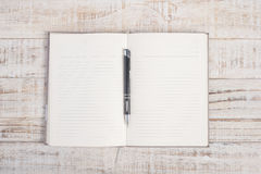 Open  notebook and pen on wood table for background Stock Images
