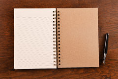 Open notebook and pen Royalty Free Stock Image