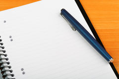 Open notebook and pen for writing. Close-up Royalty Free Stock Images