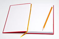 Open notebook with pencil. On white Royalty Free Stock Photography