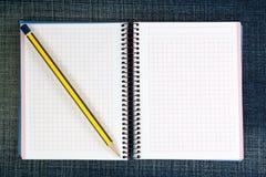 An open notebook and a pencil. Royalty Free Stock Photos