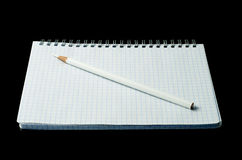 Open notebook with pencil. On a black background Royalty Free Stock Photography