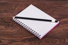 Open notebook and pencil Stock Photos