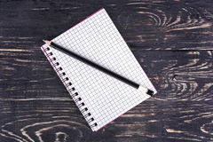 Open notebook and pencil Stock Image