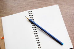 Open notebook with pencil Stock Image
