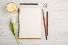 Open notebook, pencil, candle, brushes and tulip Royalty Free Stock Photo
