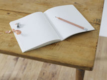 Open notebook with pencil and pencil sharpener on table elevated view Stock Photo