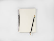 Open notebook and pencil potted on white background. Top view open notebook and pencil potted on white background Stock Photos