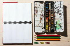 Open Notebook, Pencil and Watercolor Paints Royalty Free Stock Photography
