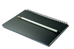 Open notebook with pencil. On a white background Royalty Free Stock Photography