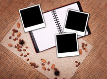 Open notebook with polaroid Stock Photography