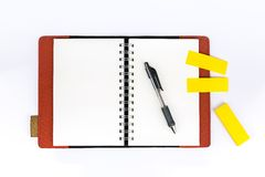 Open notebook with post it. And pen on white background royalty free stock photos