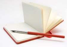 Open Notebook and Red Pen. Open Red Notebook and Red Pen Stock Photos