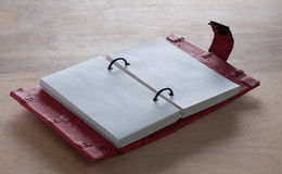 Open Notebook. Open Red Notebook  on the  wooden background Royalty Free Stock Photography