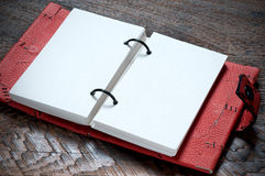 Open Notebook. Open Red Notebook  on the wooden background Royalty Free Stock Photos