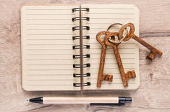 Open notebook and rusty keys, text space Stock Photography