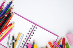 Open notebook and school or office tools on white background Stock Photos