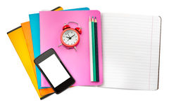 Open notebook with set of crayons and smartphone Royalty Free Stock Photos